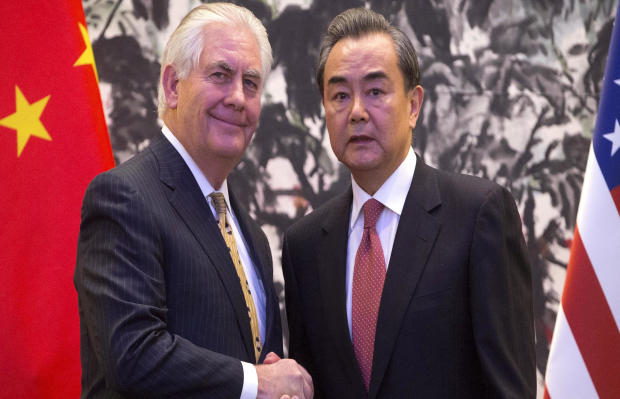 U.S. Secretary of State Rex Tillerson and Chinese Foreign Minister Wang Yi shake hands at the end of a joint press conference at the Diaoyutai State Guesthouse in Beijing, China, March 18, 2017.