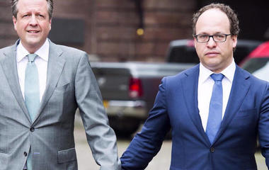 Dutch men are holding hands to support a beaten gay couple