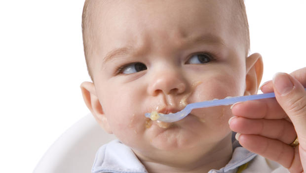 what s the right age for babies to start eating solid foods cbs news