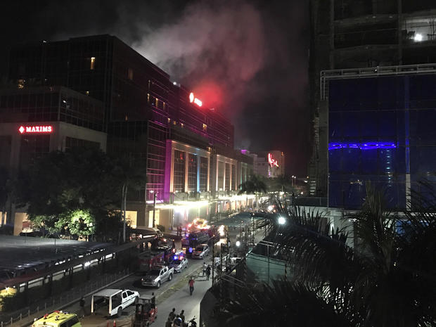 Smoke rises from the Resorts World Manila complex early June 2, 2017, in Manila, Philippines.
