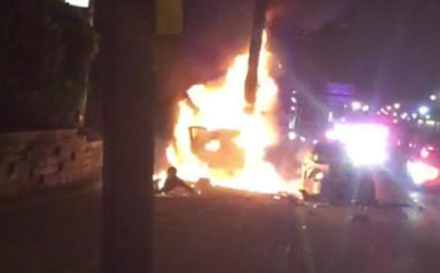 A man who had just rolled out of one of two burning cars is seen in this screen capture from cellphone video with flames coming from what looks like his upper torso after a wild police pursuit in Jersey City, N.J., late on June 4, 2017.