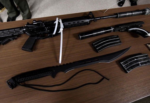 Los Angeles County sheriff's deputies show the media, during a press conference in Los Angeles, the weapons seized after they arrested a man at the Sierra Madre Metro train station in Pasadena, California, on June 21, 2017.