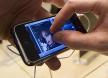 apple-introduces-iphone-fingers-closeup-ap-070629031595.jpg