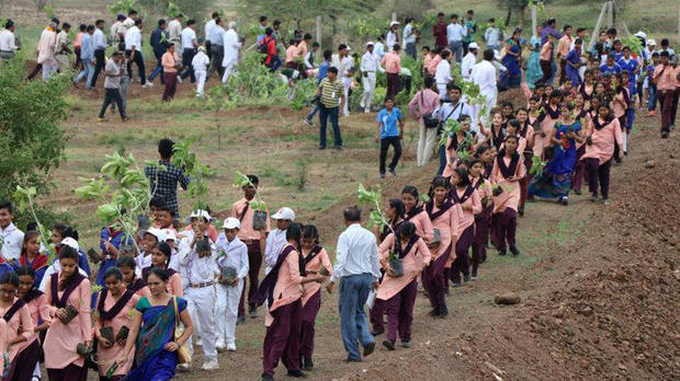 Volunteers help plant trees in India's Madhya Pradesh state on July 2, 2017.