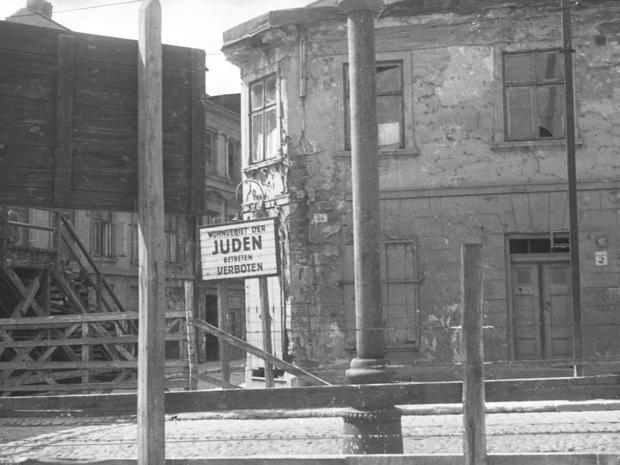 lodz-ghetto-09-sign-for-jewish-residential-area-henryk-ross.jpg