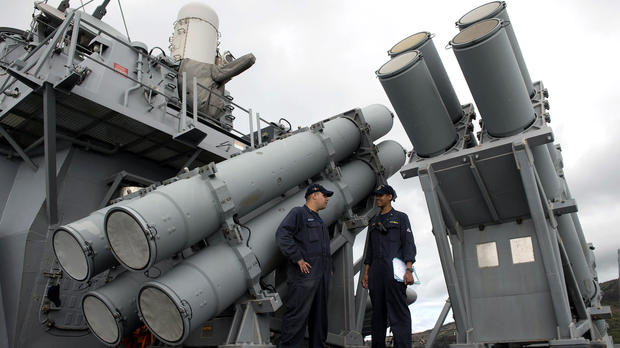 U.S. Navy personnel stand in front of a guided missile launcher during a bilateral maritime exercise between the Philippine navy and U.S. Navy aboard the USS John S. McCain in the South China Sea near waters claimed by Beijing on June 28, 2014.