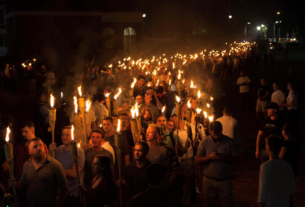 "White nationalists carry torches on the grounds of the University of Virginia, on the eve of a planned ""Unite The Right"" rally in Charlottesville, Virginia, Aug. 11, 2017."