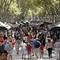 FILE PHOTO: People walk by Las Ramblas in Barcelona