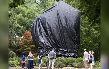 Black covers draped over Confederate statues in Charlottesville