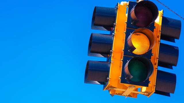 Yellow traffic light with a sky blue background