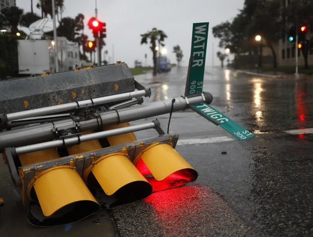 Traffic lights lie on a street after being knocked down, as Hurricane Harvey approaches in Corpus Christi