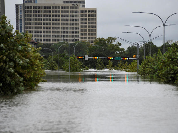 A downtown street is submerged in water from Buffalo Bayou after Hurricane Harvey inundated the Texas Gulf coast with rain causing widespread flooding, in Houston, Texas