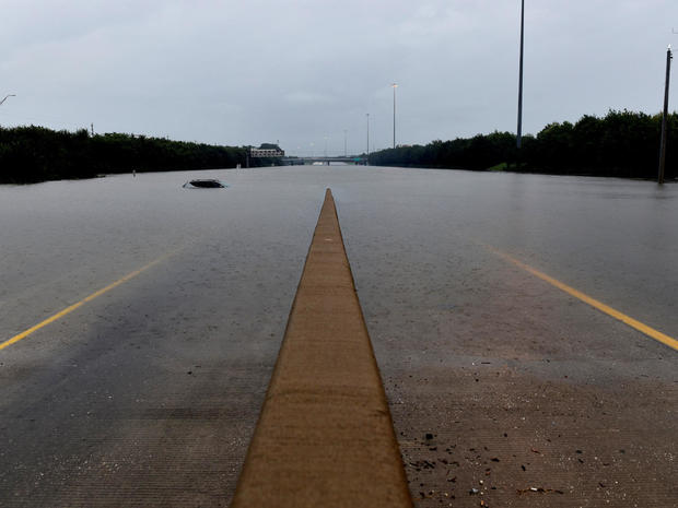An abandoned vehicle is covered by flood waters on Interstate 610 after Hurricane Harvey inundated the Texas Gulf coast with rain, in Houston