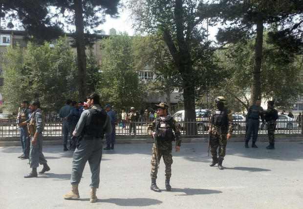 Afghan security forces keep watch at the site of attack in Kabul
