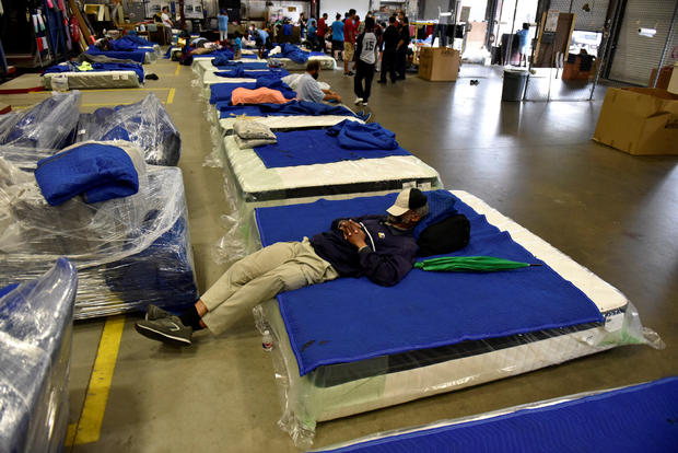 Evacuees get some rest in the warehouse at Gallery Furniture in Houston
