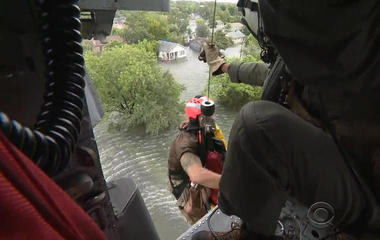 On board a Navy helicopter rescuing people stranded in East Texas
