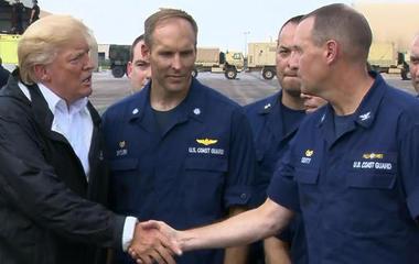 Trump greets rescue crews before heading to Louisiana