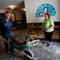 A volunteer helps clean up the damage from a Lutheran church in the aftermath of Tropical Storm Harvey in Dickinson, Texas