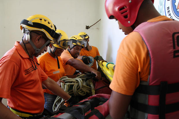 Members of the Civil Defense prepare their gear ahead of Hurricane Irma, in Santo Domingo
