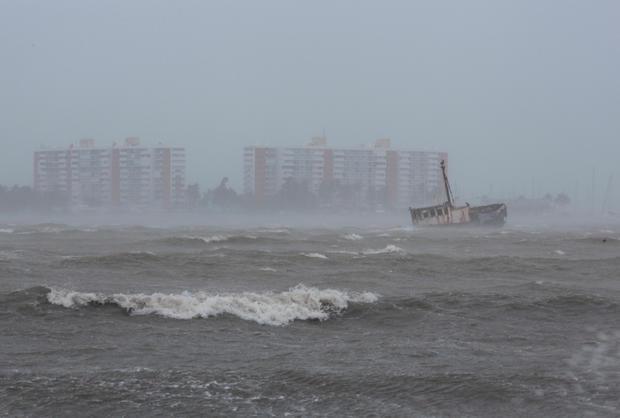 Waves battle a stranded ship in Fajardo as Hurricane Irma slammed across islands in the northern Caribbean