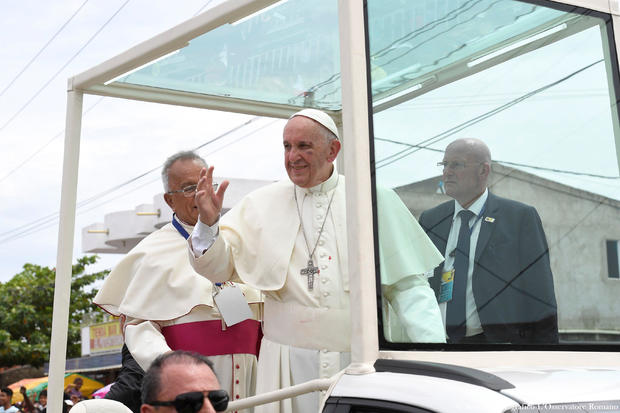 Pope Francis greets faithful from his popemobile in Cartagena