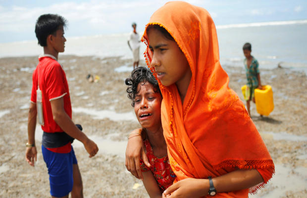 A Rohingya refugee girl cries as she arrives in Teknaf, Bangladesh, after crossing the Bangladesh-Myanmar border by boat through Bay of Bengal Sept. 14, 2017.