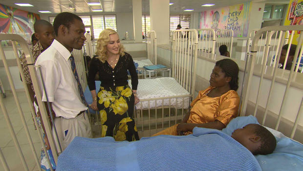madonna-with-patients-malawi-hospital-620.jpg