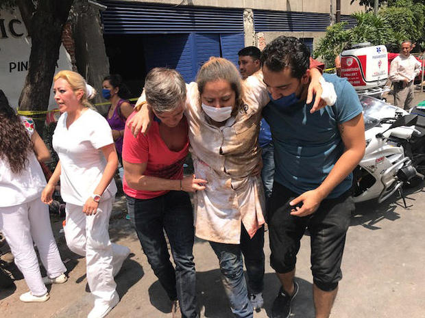 People are seen injured after an earthquake hit in Mexico City