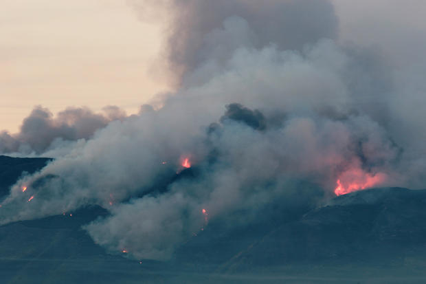 The Canyon Fire burns hillsides in Corona, California