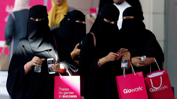 Saudi women take part in a Glowork exhibition in Riyadh, Saudi Arabia, Sept. 28, 2017.
