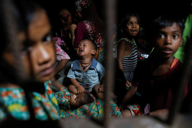 Rohingya refugee children who just arrived by wooden boats from Myanmar rest in a relief centre in a madrasa in Shah Porir Dwip