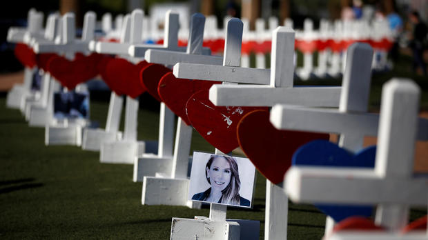 A photograph hangs from one of the 58 white crosses set up for the victims of the Route 91 Harvest music festival mass shooting in Las Vegas, Nevada, Oct. 5, 2017.