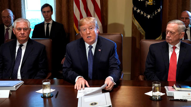 U.S. President Donald Trump speaks during a cabinet meeting, flanked by Secretary of State Rex Tillerson and Secretary of Defense James Mattis, at the White House in Washington