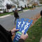 Democratic canvassers leave door-tags reminding residents to vote on election day in Lawrence, New Jersey