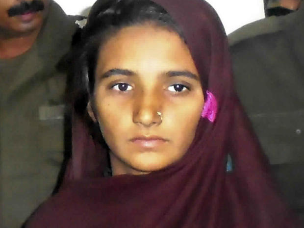 Aasia Bibi is presented to journalists at a police station in Muzaffargarh, Pakistan, Oct. 30, 2017.