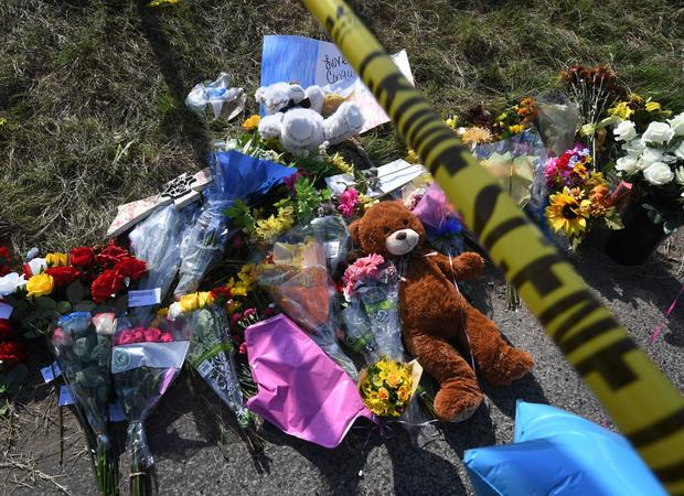 Texas church shooting memorial flowers and crime scene tape
