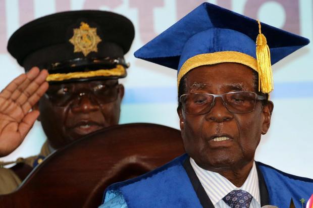 Zimbabwe President Robert Mugabe attends a university graduation ceremony in Harare