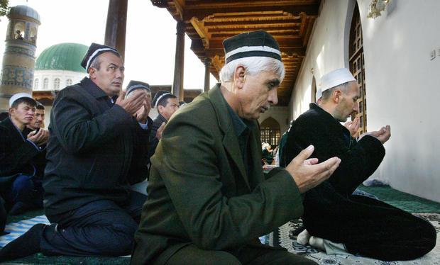 Tajik Muslims pray in the Mavlonoa mosqu