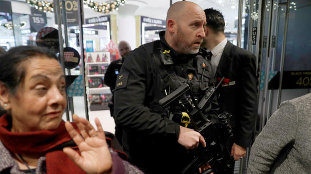 Armed police officers mix with shoppers in an Oxford Street store in London, Britain, Nov. 24, 2017.