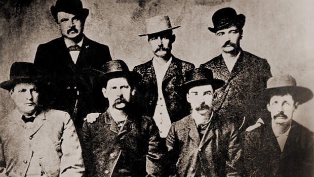 'Dodge City Peace Commissioners' were a gang of gunfighters, lawmen, and saloon owners who fought to keep Dodge City corrupt and under their control. (L to R): Charles Bassett, W. H. Harris, Wyatt Earp, Luke Short, L. McLean, Bat Masterson, Neal Brown. Ca