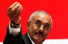 Yemen's then-President Ali Abdullah Saleh gestures during a gathering of supporters in Sanaa Feb. 20, 2011.