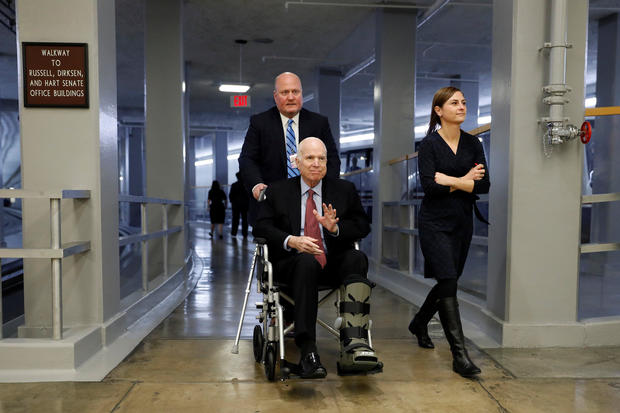 Sen. John McCain heads to the Senate floor ahead of votes on Capitol Hill in Washington