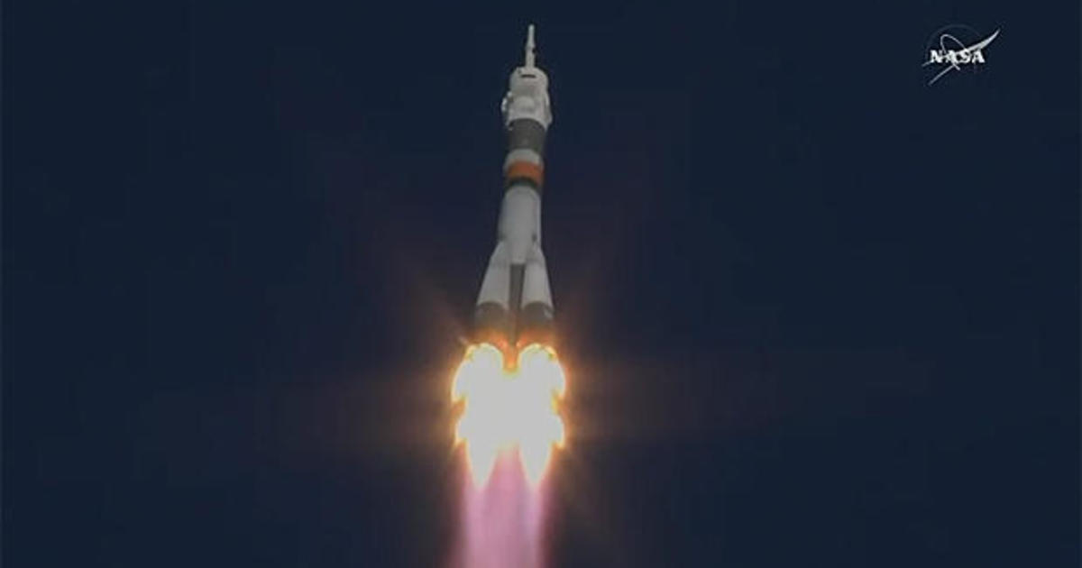 Soyuz blasts off for station while SpaceX cargo ship closes in