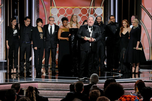"""Bruce Miller, producer and writer for """"The Handmaids Tale"""", Hulu, accepting the award for Best Television Series Drama at the 75th Golden Globe Awards in Beverly Hills"""