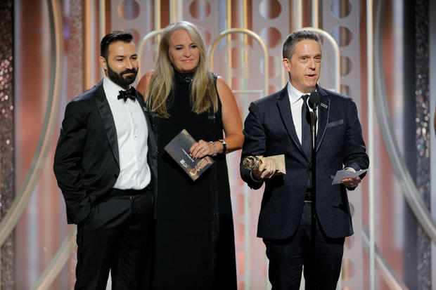 """Lee Unkrich, director of """"Coco"""", accepts the award for Best Motion Picture Animated at the 75th Golden Globe Awards in Beverly Hills"""