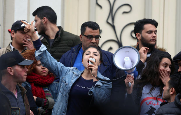 Graduate shouts slogans during protests against rising prices and tax increases, in Tunis