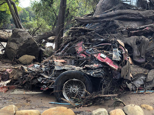 Parts of a car are entangled in debris after mudslides in Montecito