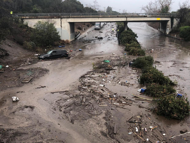 Abadoned cars stuck in flooded water on the freeway after a mudslide in Montecito
