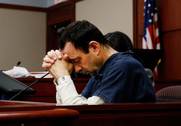Larry Nassar listens to a victim during his sentencing hearing in Lansing