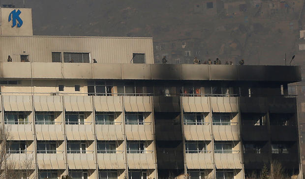 Afghan security forces are seen at the roof top of the Intercontinental Hotel in Kabul,ÊAfghanistan